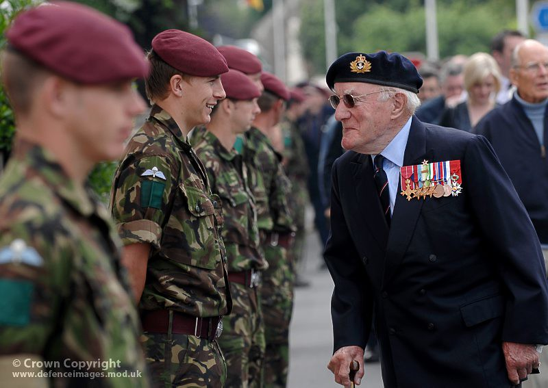 A Royal Navy Veteran Shares a Joke With a Young Paratrooper